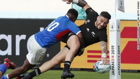 New Zealand's scrum-half TJ Perenara scores a spectacular final try in his side's 71-9 win over Namibia in their  Rugby World Cup Pool B match at the Tokyo Stadium.