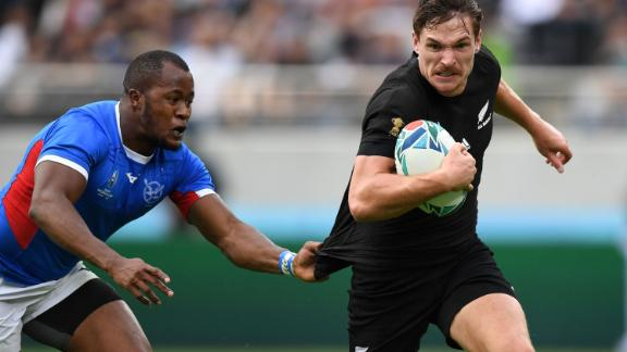 New Zealand's wing George Bridge is tackled by Namibia's wing Lesley Klim.
