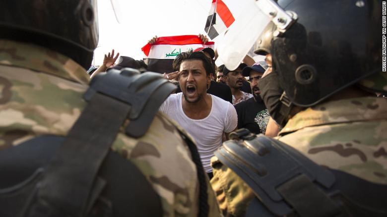 A protestor gestures in front of security forces during a demonstration on October 2.