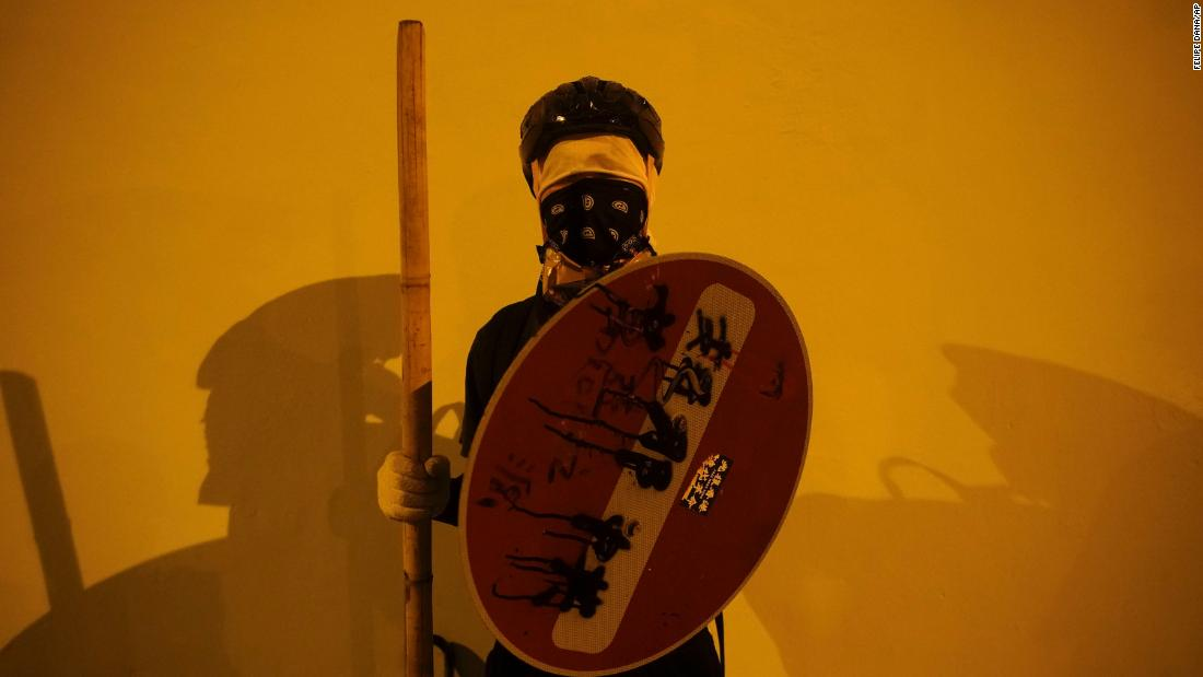 A masked protester stops for a portrait in Hong Kong on Sunday, October 6.