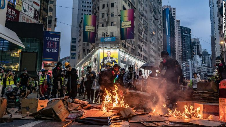 Pro-democracy protesters set a barricade on fire in Causeway Bay district, Hong Kong, on Sunday.