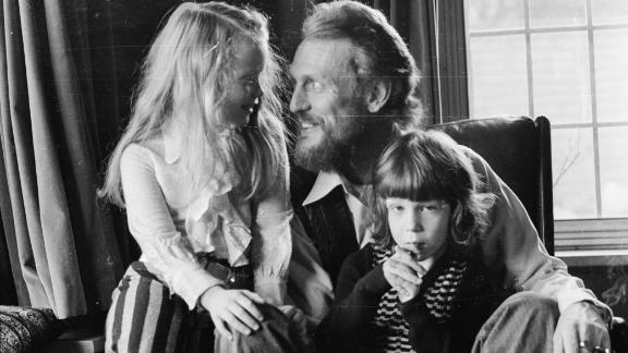 Ginger Baker pictured at home with his children in December 1974.