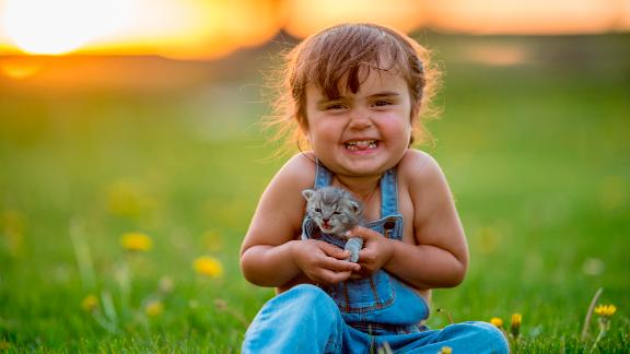 Pets bring joy to our lives (yes, dog lovers -- even cats). Need more proof than the gleeful smile on this child's face? A study from Indiana University found simply watching cat videos boosted energy and healthy positive emotions and decreased negative feelings.