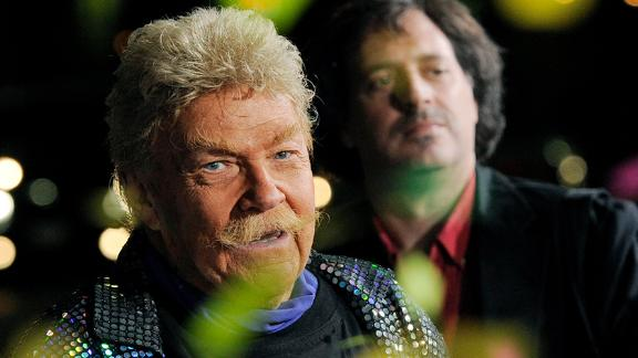 """Comedian Rip Taylor throws confetti on photographers at the premiere of the film """"Jackass 3D"""" in Los Angeles, Wednesday, Oct. 13, 2010, in Los Angeles. (AP Photo/Chris Pizzello)"""