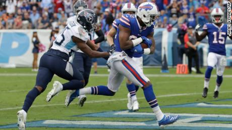 In his first NFL game, Buffalo Bills wide receiver Duke Williams scores a touchdown on Sunday against the Tennessee Titans.