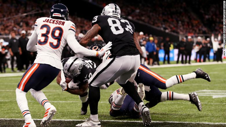 DeAndre Washington of the Oakland Raiders scores his team's second touchdown against the Bears.