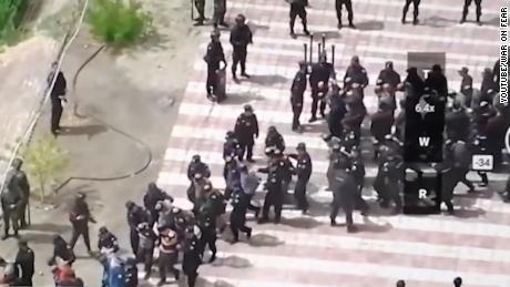 Video shows hundreds of blindfolded and bound men