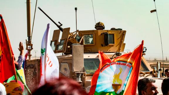"A soldier sits atop an armoured vehicle during a demonstration by Syrian Kurds against Turkish threats at a US-led international coalition base on the outskirts of Ras al-Ain town in Syria's Hasakeh province near the Turkish border on October 6, 2019. - Ankara had reiterated on October 5 an oft-repeated threat to launch an ""air and ground"" operation in Syria against a Kurdish militia it deems a terrorist group. (Photo by Delil SOULEIMAN / AFP) (Photo by DELIL SOULEIMAN/AFP via Getty Images)"