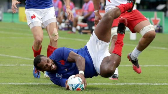 France's Alivereti Raka touches the ball down to score an early try against Tonga in his side's narrow 23-21 win in Pool C.