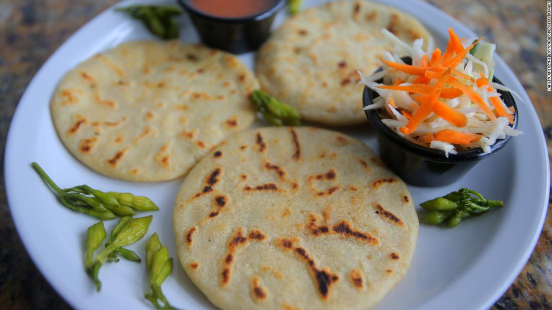 <strong>Pupusas, El Salvador. </strong>This griddled corn bread with a variety of fillings is both a beloved snack and a national icon.