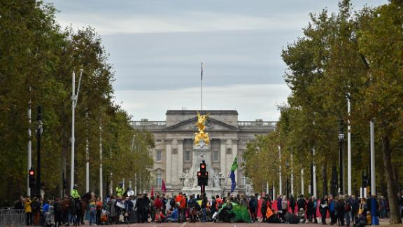 Climate change activists block The Mall as they demonstrate near Buckingham Palace.