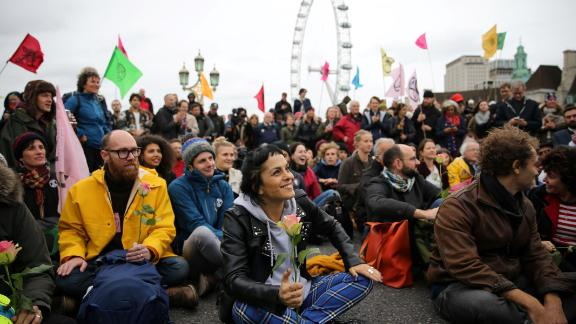 Activists gather on Westminster Bridge during the protests.