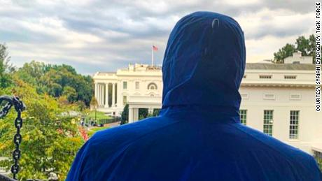 Caesar looks toward the White House after a meeting with administration officials in a nearby building.