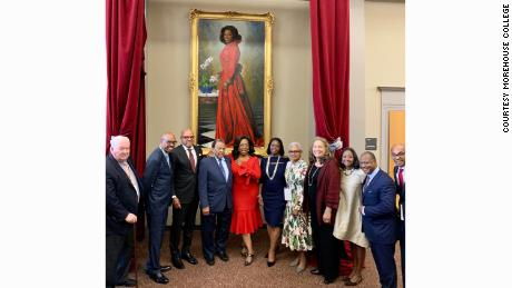 Oprah Winfrey stands in front of a portrait unveiled in her honor at Morehouse College in Atlanta, Georgia, on Monday, October 7, 2019.