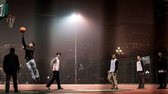 BEIJING, CHINA - NOVEMBER 26:  Chinese men play a game of pick-up basketball on an outdoor court in smoggy weather on November 26, 2014 in Beijing, China.United States President Barack Obama and China