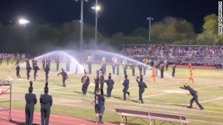 Image result for football field sprinklers playing