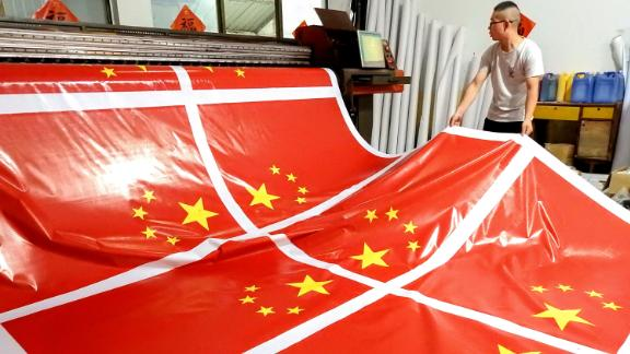 A worker produces inkjet printing national flags at a factory in Lianyungang in China