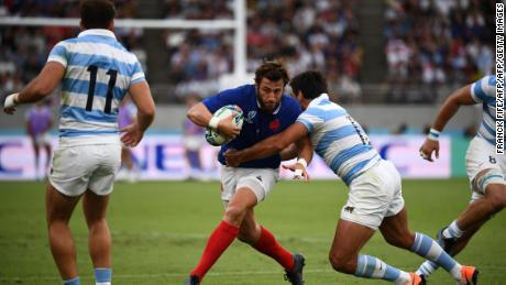 France's full back Maxime Medard (L) is tackled by  Argentina's centre Matias Orlando (R) during the  match between France and Argentina.