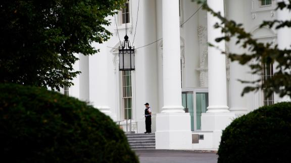 A member of the US Secret Service stands at attention outside the entrance to the White House on October 6, 2019 in Washington, DC.