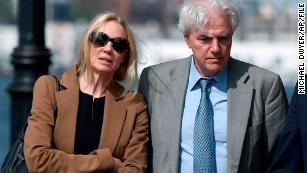 Marcia and Gregory Abbott leave federal court after they pleaded guilty to conspiracy charges on May 22, 2019.