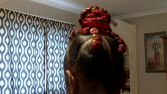 Marian Scott sent to school with red extensions braided into a bun.