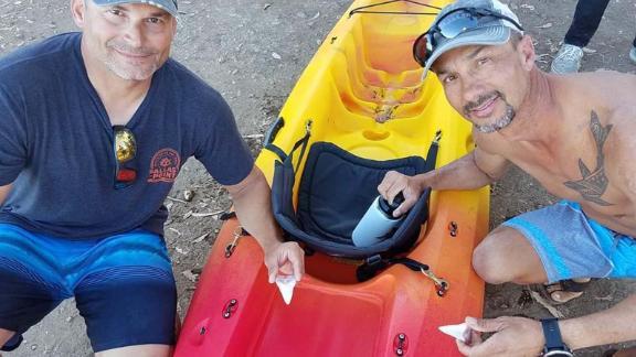 Jon Chambers, left, and Danny McDaniel hold the shark teeth.