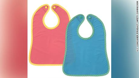 The recalled infant bibs appear as a pair in a pack, and were sold in stores worldwide