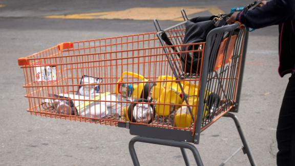 A customer pushes a shopping cart with batteries and flashlights in a Home Depot Inc. parking lot in Emeryville, California, U.S., on Tuesday, Oct. 8, 2019. Come Wednesday, utility PG&E Corp. plans to shut electricity to 800,000 California homes and businesses -- representing roughly 2.4 million people -- to prevent wildfires as high winds are forecast to whip through the state.