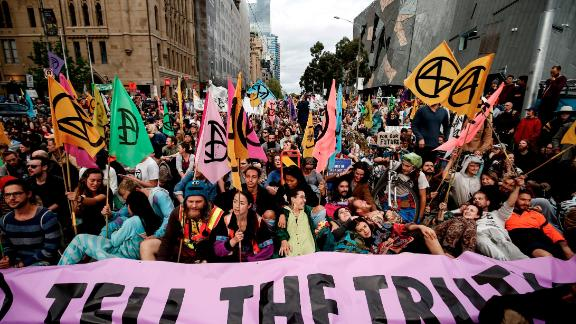 """MELBOURNE, AUSTRALIA - OCTOBER 07: Protestors are seen on October 07, 2019 in Melbourne, Australia. The event was organised as part of Extinction Rebellion's global """"Week Of Action"""" in 60 cities across the world to bring attention to climate change and push governments to declare a climate emergency. (Photo by Darrian Traynor/Getty Images)"""