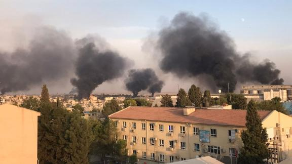 A photo taken from Turkey's Sanliurfa province shows smoke rising at the site of Ras al-Ain.