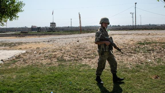 AKCAKALE, TURKEY - OCTOBER 09: Turkish soldiers stand guard on the Turkish side of the border between Turkey and Syria on October 09, 2019 in Akcakale, Turkey. Military personnel and vehicles gathered near the border ahead of a campaign to extend Turkish control of more of northern Syria, a large swath of which is currently held by Syrian Kurds, whom Turkey regards as a threat. U.S. President Donald Trump granted tacit American approval to this military campaign, withdrawing his country's troops from several Syrian outposts near the Turkish border. (Photo by Burak Kara/Getty Images)