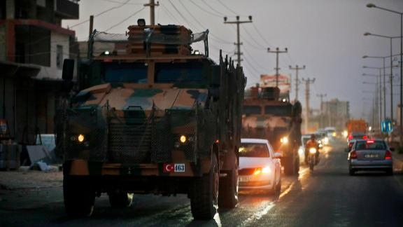 Turkish military vehicles drive through Akcakale, Turkey, near the border.