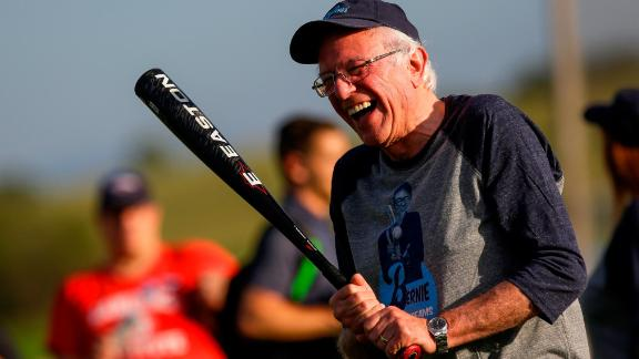 Democratic presidential candidate Sen. Bernie Sanders shares a laugh as he warms up before a softball game on August 19 in Dyersville, Iowa.