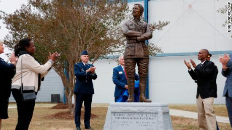 Harriett Bullard White, far left, and William Bullard, far right,Harr join in applause after the statue of Eugene Bullard was unveiled Wednesday at the Museum of Aviation near Robins Air Force Base in Georgia.