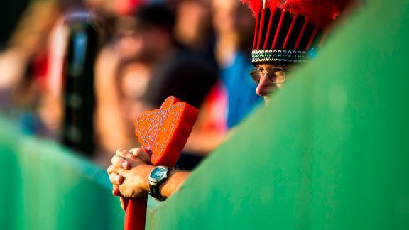 A Braves fan holds a foam tomahawk.