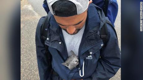 Snyder carried this kitten with him for a day until a friend offered to look after it for him.