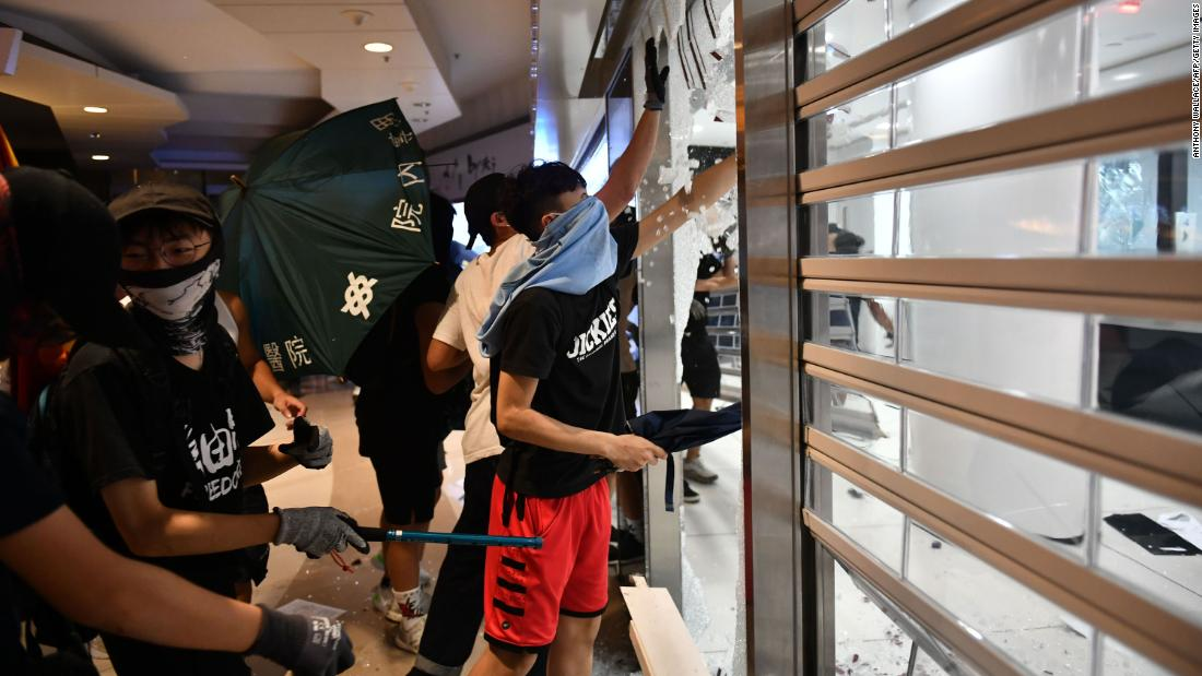Protesters smash up a Bank of China branch on Monday, October 7.