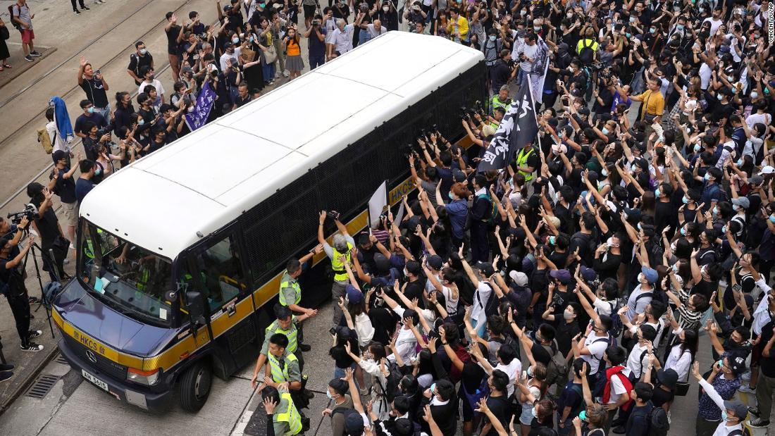"Supporters surround a police bus carrying political activist Edward Leung as it leaves the High Court in Hong Kong on Wednesday, October 9. Several hundred masked protesters gathered at Hong Kong's High Court for the appeal hearing of Leung, <a href=""https://www.cnn.com/2018/06/11/asia/edward-leung-hong-kong-jailed-intl/index.html"" target=""_blank"">who was sentenced to six years in prison</a> for his part in a violent clash with police."