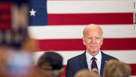 Democratic presidential candidate, former Vice President Joe Biden stands on stage while the crowd applauds during a campaign event on October 9, 2019 in Manchester, New Hampshire. For the first time, Biden has publicly called for President Trump to be impeached.