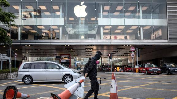 A pro-democracy protester blocks a road outside the Apple store during clashes with police on October 01, 2019 in Hong Kong, China. Pro-democracy protesters marked the 70th anniversary of the founding of the People