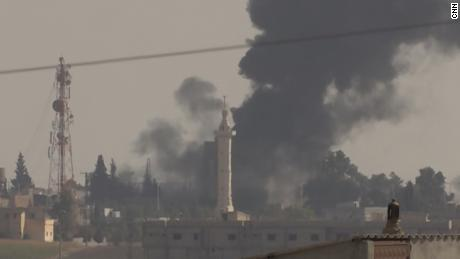 CNN signal near the Turkish border showing black smoke rising from the Syrian town of Tal Abyad