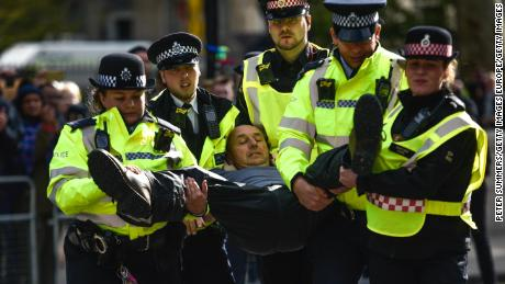 Police arrest an activist during Extinction Rebellion demonstrations on Whitehall on October 9.