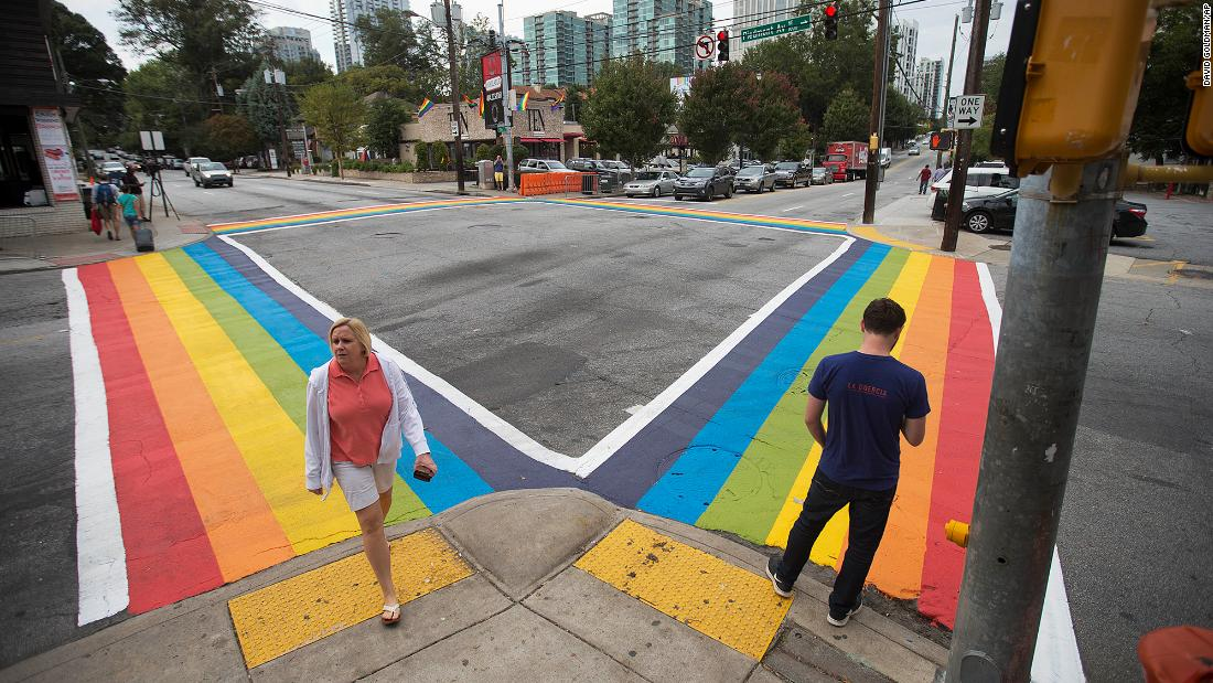 Atlanta defends its rainbow crosswalks as symbols of pride. Federal highway officials say it impacts road safety