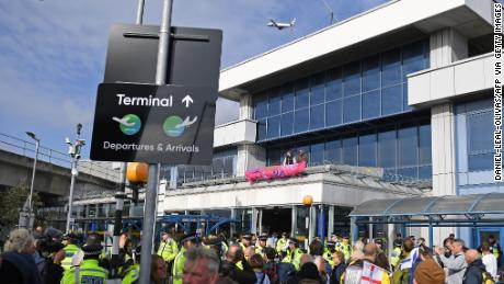 Demonstrators protest at London City Airport.