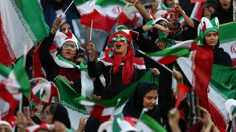 Iranian women cheer during a soccer match between their national team and Cambodia in the 2022 World Cup qualifier at the Azadi Stadium in Tehran, Iran, Thursday, Oct. 10, 2019.