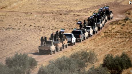 Turkey-backed fighters head toward the Syrian town of Tal Abyad.