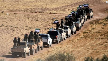 """Turkey-backed FSA fighters are heading toward Syrian town of Tal Abyad from Turkish border town of Akcakale, Turkey, Thursday, Oct. 10, 2019. Turkish President Recep Tayyip Erdogan says that there have been 109 """"terrorists killed"""" — a reference to Syrian Kurdish fighters — since Ankara launched an offensive into Syria the previous day.  (DHA via AP)"""