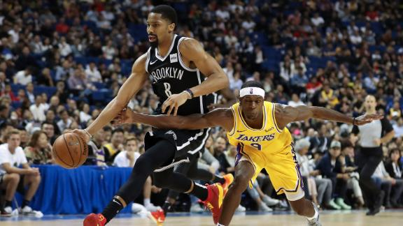 Spencer Dinwiddie #8 of of the Brooklyn Nets in action against Rajon Rondo #9 of the Los Angeles Lakers in Shanghai.
