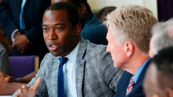 Richmond Mayor Levar Stoney, left, speaks at a gun violence prevention discussion this year.