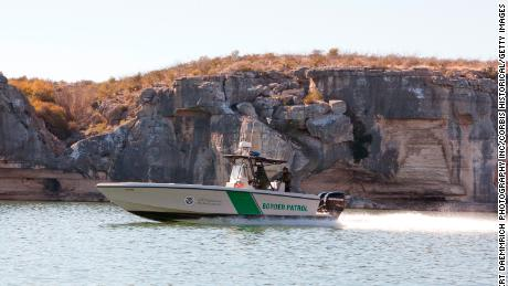 A dual-engine Border Patrol boat surveys the Rio Grande west of Del Rio, Texas.